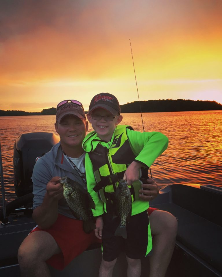 Dad & Son with Crappie in Sunset